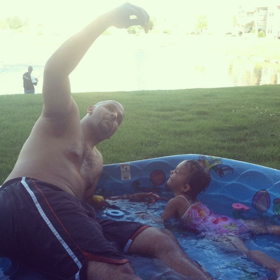 Basil Duncantell with daughter in kiddie pool