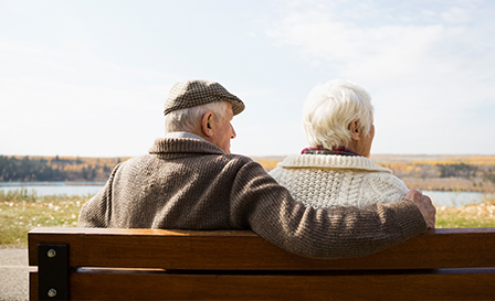 Elderly couple sitting on a bench