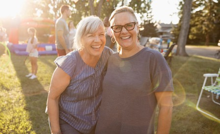 Two women smiling at the camera.