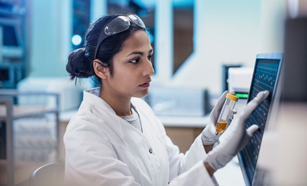 Female Scientist Working in The Lab, Using Computer Screen