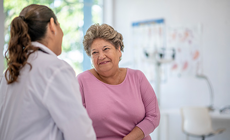 Female Hispanic doctor at an appointment with an older Hispanic woman.