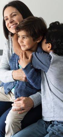 Mother and two boys hugging